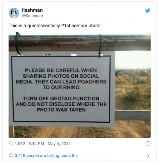 """An Instagram image of a warning sign hanging from a metal gate. The sign reads: """"Please be careful when sharing photos on social media. they can lead poachers to our rhino. Turn off geotag function and do not disclose where the photo was taken."""""""